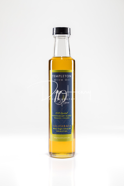 Templeton Olive Oil - for Chris Enter.<br /> Studio photography by Dan Henry / DanHenryPhotography.com<br /> <br /> * 2 Strips F8 parallel with product ELB power 1.0<br /> &bull; 1 Speedlite Hair slightly in front of product F8 output 1/4 .3 power | 20mm <br /> <br /> Iso 100 / 80mm / nodal point in line with center of product