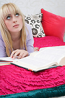 Teenage girl (16-17) lying on bed looking up