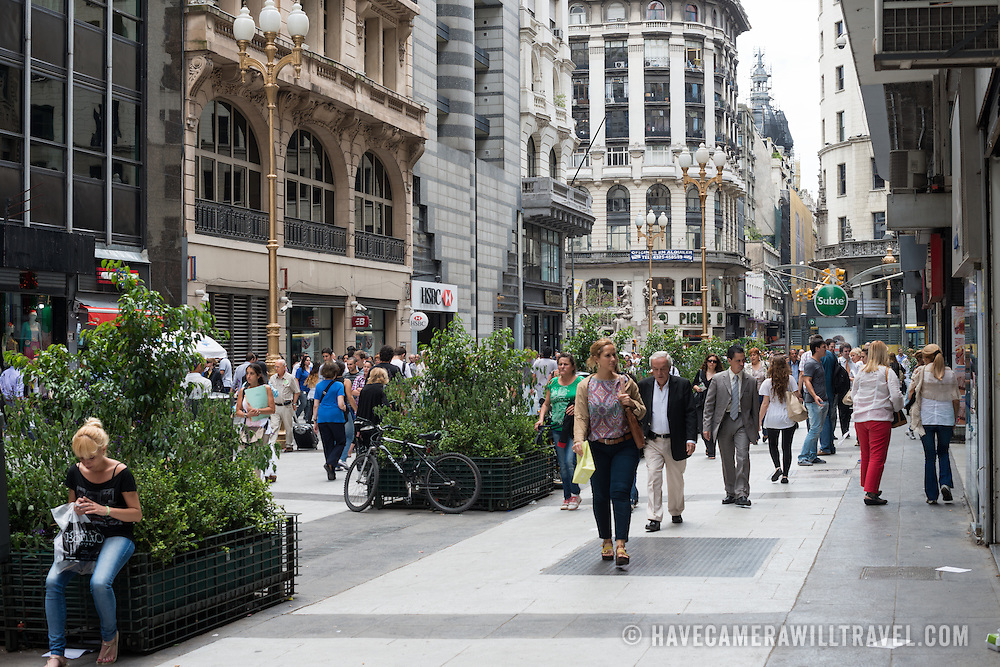 A pedestrian mall lined with shops and retail stores in downtown Buenos Aires, Argentina.