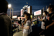 Supporters of The Tokyo swallows watch the match at the Jingu Baseball Stadium in Tokyo during a game Tokyo Swallows VS Hiroshima Carp, Japan. 21/04/2017-Tokyo, JAPAN