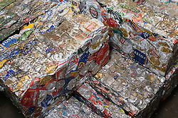 Bale of old aluminium cans at a metal recycling centre,