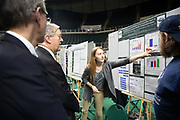 Emily Trzeciak (Center Right) presents her research to President Nellis (Center Left) and the Vice President for Research; and Dean of the Graduate College Joe Shields (Left) at the Student Expo. Photo by Ben Siegel