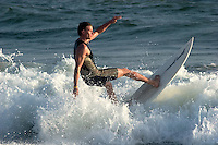 Surfer About to Fall Off Surfboard at Surf City USA, Huntington Beach, California
