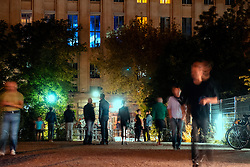 View at night  of people waiting outside entrance to famous Berghain nightclub in Friedrichshain Berlin Germany