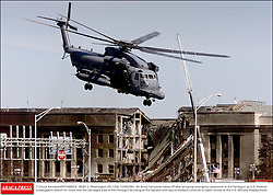 © Chuck Kennedy/KRT/ABACA. 28581-2. Washington-DC-USA, 12/09/2001. An Army helicopter takes off after bringing emergency personnel to the Pentagon as U.S. Federal Investigators search for clues near the damaged area of the Pentagon Building as fire fighte  | 28581_02