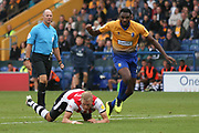 Dean Moxey of Exeter City (21) is hauled down by Hayden White of Mansfield Town (2) in the box during the EFL Sky Bet League 2 match between Mansfield Town and Exeter City at the One Call Stadium, Mansfield, England on 15 September 2018.