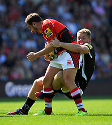 Olly Barkley (London Welsh) is tackled - Photo mandatory by-line: Patrick Khachfe/JMP - Mobile: 07966 386802 06/09/2014 - SPORT - RUGBY UNION - Oxford - Kassam Stadium - London Welsh v Exeter Chiefs - Aviva Premiership
