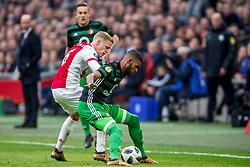 21-01-2018 NED: AFC Ajax - Feyenoord, Amsterdam<br /> Ajax was met 2-0 te sterk voor Feyenoord / Donny van de Beek #6 of AFC Ajax, Jerry St. Juste #4 of Feyenoord