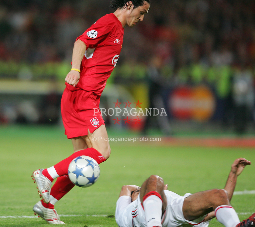 ISTANBUL, TURKEY - WEDNESDAY, MAY 25th, 2005: AC Milan's player handles the ball in front of Liverpool's Luis Garcia  during the UEFA Champions League Final at the Ataturk Olympic Stadium, Istanbul. (Pic by David Rawcliffe/Propaganda)