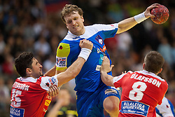 David Miklavcic of Slovenia between Alexander Petersson of Iceland and Thorir Olafsson of Iceland during handball match between Iceland and Slovenia in  3rd Round of Preliminary Round of 10th EHF European Handball Championship Serbia 2012, on January 20, 2012 in Millennium Center, Vrsac, Serbia. Slovenia defeated Iceland 34-32. (Photo By Vid Ponikvar / Sportida.com)