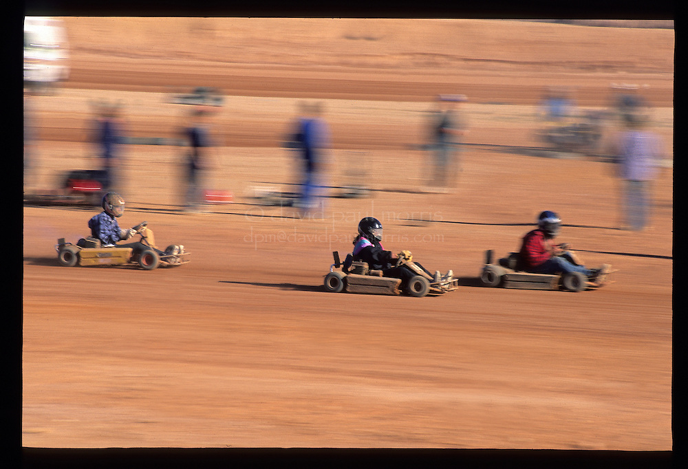COOBER PEDY, AUSTRALIA:  Stock car racing in the desert in Coober Pedy, Australia. The opal mining town in central Australia is known for it's underground homes and quirky events such as the Easter Golf Tournament played out over a desert golf course and dirt road racing. Photograph by David Paul Morris