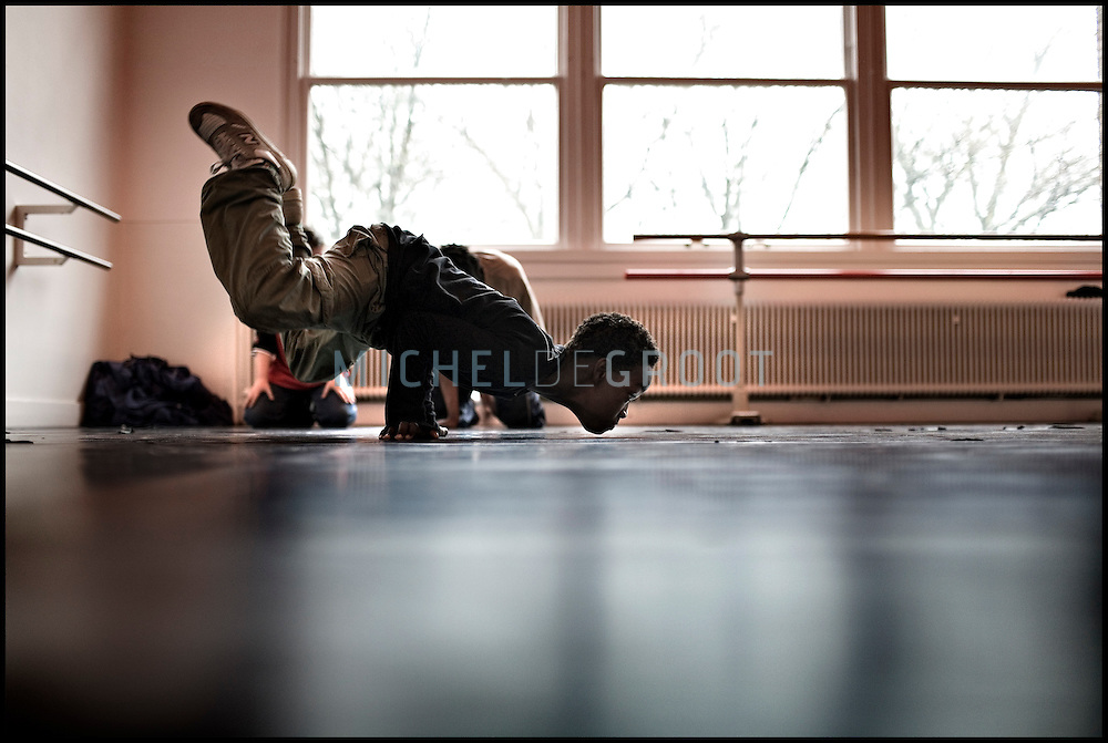 The xx year old Damien is working on his breakdance technique at the HipHop2 (quadrate) School in Arnhem in the Netherlands. At the Hip Hop school youngsters from 10 to 25 can take workshops in rap, hip hop, breakdance and DJ Spinning...In Arnhem is sinds januari 2006 een HipHopschool gevestigd. Op deze school kunnen jongeren van tussen de 10 en 25 jaar workshops volgen in Rap, R&B zang, Breakdance, HipHop dance en DJ Spinning. Dit iniatief is tot stand gekomen door een samenwerking van Stichting Interart en de Arnhemse Rapgroep ' Andere Gekte'.  Arnhem, NETHERLANDS - 15-2-06: