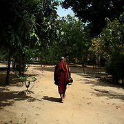 May 14, 2013 - Mandalay, Myanmar: A buddhist monk walks the grounds of a pagoda in central Mandalay. The city, famous for its pagodas, is a popular tourist destination for buddhist devotees from all over Southeast Asia. CREDIT: Paulo Nunes dos Santos