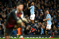 Manchester City's Raheem Sterling celebrates scoring his sides third goal of the game during the Premier League match at the Etihad Stadium, Manchester.