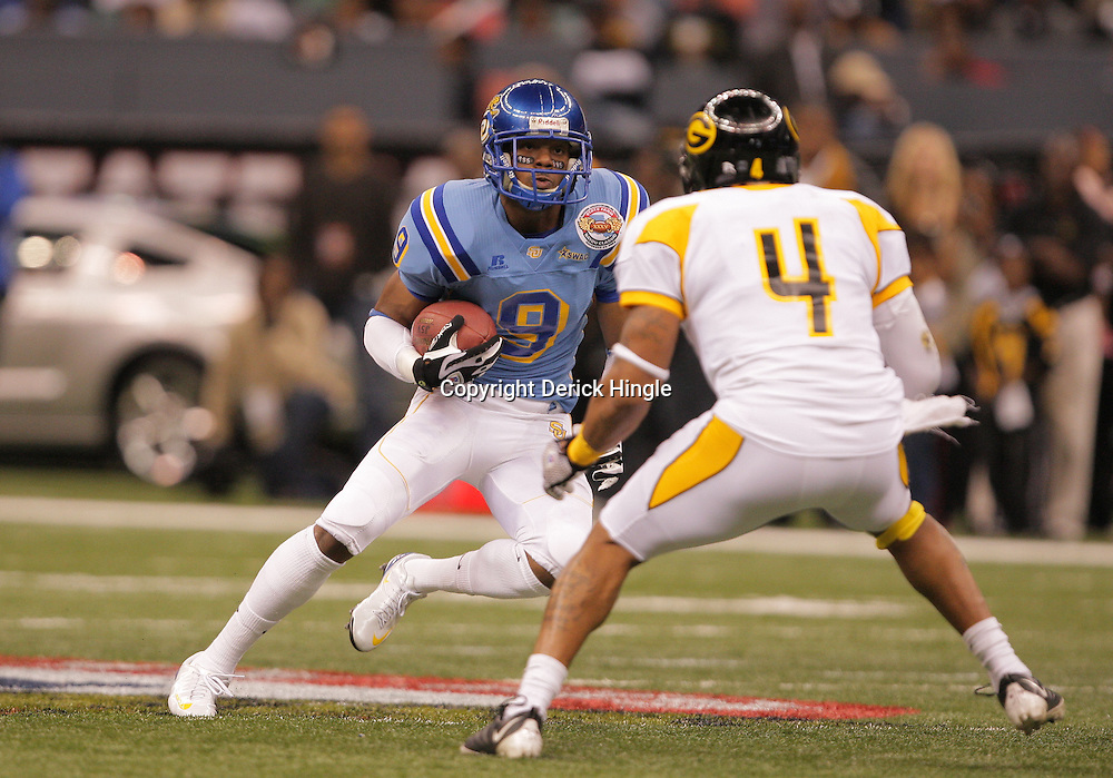 2008 November, 29: Southern University wide receiver Clevan White (9) tries to evade the tackle of Jeffrey Jack (4) during the 35th annual State Farm Bayou Classic between Southern University and Grambling State University at the Louisiana Superdome in New Orleans, LA.  .