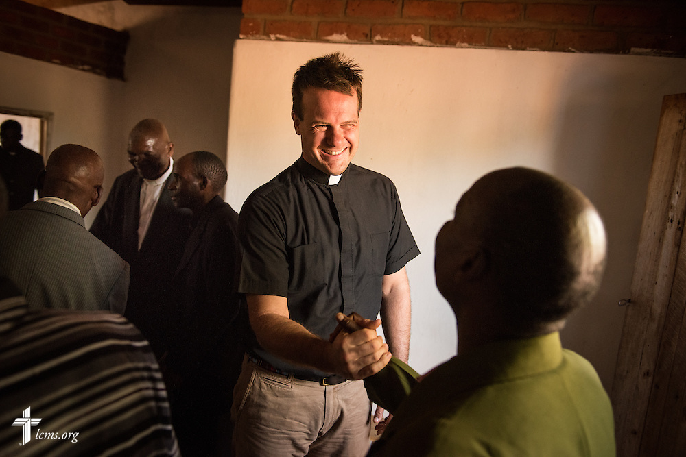 The Rev. Shauen Trump, LCMS missionary and area director for Eastern and Southern Africa, greets parishioners with traditional African handshakes before worship at a Confessional Lutheran Church–Malawi Synod parish on Sunday, Sept. 27, 2015, in Chingale, Malawi. LCMS Communications/Erik M. Lunsford