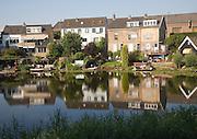 Detached suburban houses in village of Kinderdijk Ablasserdam, near Rotterdam, Netherlands