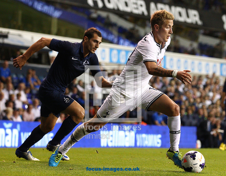Picture by Paul Terry/Focus Images Ltd +44 7545 642257<br /> 29/08/2013<br /> Lewis Holtby of Tottenham Hotspur and Giorgi Merebashvili of Dinamo Tbilisi during the UEFA Europa League match at White Hart Lane, London.