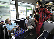 """Two women look at actor Fran Jackson (R) as he travels in tram, on September 2, 2010, in the Northern Spanish city of Bilbao. Actors and dancers, dressed up like zombies, visited Bilbao to promote the musical show """"Forever, King of Pop"""", based on Michael Jackson's """"Thriller"""". PHOTO/Rafa Rivas"""