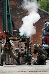 Reenactors take part in a firing display as a Mortar team of the Panzer Grenadier Division Großdeutschland at<br />
