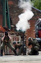 Reenactors take part in a firing display as a Mortar team of the Panzer Grenadier Division Gro&szlig;deutschland at<br /> Elsecar 1940s Weekend <br /> 4 September 2010<br /> Images &copy; Paul David Drabble