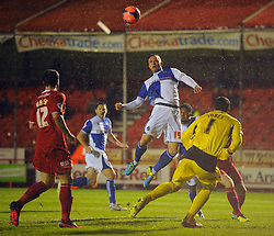 Bristol Rovers' Chris Beardsley leaps to head the ball in the Crawley Town penalty area - Photo mandatory by-line: Seb Daly/JMP - Tel: Mobile: 07966 386802 18/12/2013 - SPORT - FOOTBALL - Broadfield Stadium - Crawley - Crawley Town v Bristol Rovers - FA Cup - Replay