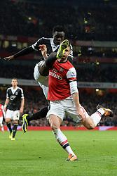 Southampton's Victor Wanyama and Arsenal's Oliver Giroud compete for the ball - Photo mandatory by-line: Mitchell Gunn/JMP - Tel: Mobile: 07966 386802 23/11/2013 - SPORT - Football - London - Emirates Stadium - Arsenal v Southampton - Barclays Premier League