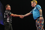 Gerwyn Price shakes hand with Peter Wright before the start during the Grand Slam of Darts, at Aldersley Leisure Village, Wolverhampton, United Kingdom on 17 November 2019.