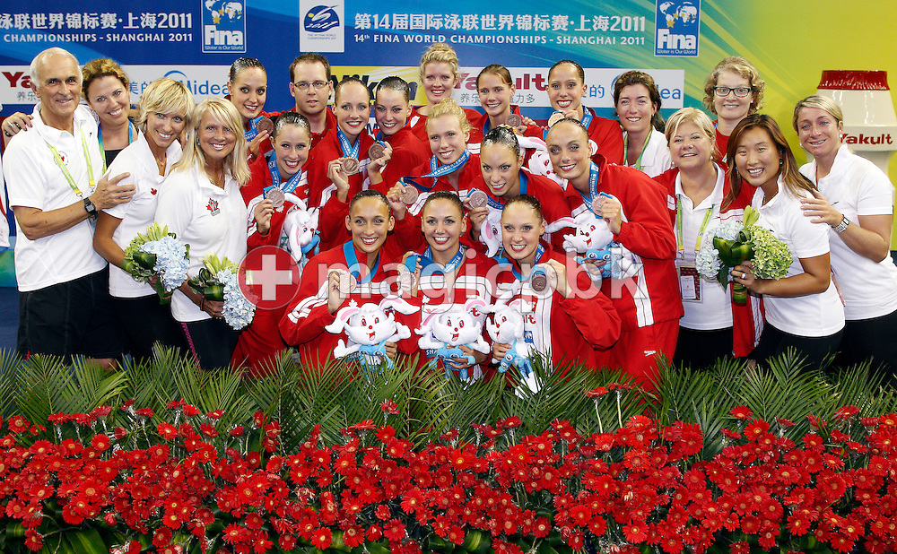 The team of Canada poses with their Bronze medals after finishing third in the Synchronized (synchronised) Swimming Team Free Combination final during the 14th FINA World Aquatics Championships at the Oriental Sports Center in Shanghai, China, Thursday, July 21, 2011. (Photo by Patrick B. Kraemer / MAGICPBK)