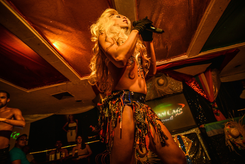 A perfomer lip-synchs to a Shakira song on stage during a performance at the Cool Cafe, a comedy club well known for their transvestite lip-synching show in Caracas, Venezuela.