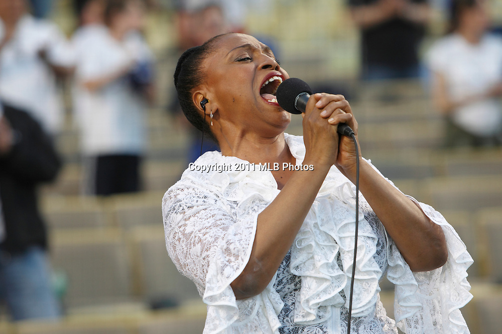LOS ANGELES, CA - APRIL 15:  Singer Jenifer Lewis sings the National Anthem prior to the game between the St. Louis Cardinals and the Los Angeles Dodgers on Friday April 15, 2011 at Dodger Stadium in Los Angeles, California. (Photo by Paul Spinelli/MLB Photos via Getty Images) *** Local Caption *** Jenifer Lewis