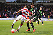 Stoke City midfielder, on loan from Chelsea, Marco van Ginkel  tries to stop Doncaster Rovers defender Cedric Evina  during the The FA Cup third round match between Doncaster Rovers and Stoke City at the Keepmoat Stadium, Doncaster, England on 9 January 2016. Photo by Simon Davies.