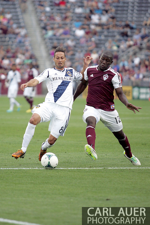 July 27th, 2013 - LA Galaxy midfielder Marcelo Sarvas (8) and Colorado Rapids midfielder Hendry Thomas (12) battle for control of the ball in the second half of action in the Major League Soccer match between the LA Galaxy and the Colorado Rapids at Dick's Sporting Goods Park in Commerce City, CO