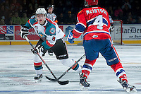 KELOWNA, CANADA -JANUARY 29: Colten Martin #8 of the Kelowna Rockets is checked by Jeremy McIntosh #4 of the Spokane Chiefs on January 29, 2014 at Prospera Place in Kelowna, British Columbia, Canada.   (Photo by Marissa Baecker/Getty Images)  *** Local Caption *** Cole Martin;