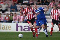 Photo: Pete Lorence.<br />Lincoln City v Stockport County. Coca Cola League 2. 07/04/2007.<br />Lee Beevers and Wayne Hennessey battle for the ball.