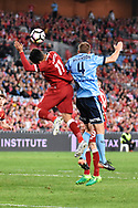 May 24, 2017:Liverpool FC player Roberto Firmino (11) and Sydney FC defender Alex WILKINSON (4) fight for the ball  at the soccer match, between English Premiere League team Liverpool FC and Sydney FC, played at ANZ Stadium in Sydney, NSW Australia.