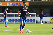 AFC Wimbledon defender Tennai Watson (2) warming up during the EFL Sky Bet League 1 match between AFC Wimbledon and Portsmouth at the Cherry Red Records Stadium, Kingston, England on 13 October 2018.