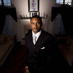 Nnamdi Asomugha, cornerback for the Oakland Raiders with a picture of his mother Lilian Asomugha in the background at his Torrance, Calif., home February 24. 2008 prepares for the Children Uniting Nations Awards Celebration at the Beverly Hilton in Beverly Hills, Calif. <br /> WKB