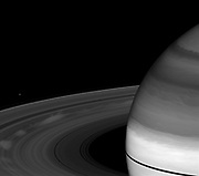 Spokes, those ghostly radial markings on Saturn's B ring, appear bright compared to the rings in this image taken a little more than a month after the planet's August 2009 equinox. Cassini.