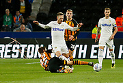 Leeds United defender Barry Douglas (3) is tackled by Hull City midfielder Markus Henriksen (22)  during the EFL Sky Bet Championship match between Hull City and Leeds United at the KCOM Stadium, Kingston upon Hull, England on 2 October 2018.