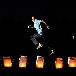 Dustin Chin runs a lap during an American Cancer Society Relay For Life event at the high school in Sheldon, Iowa. The event, which brought in more than $40,000 for cancer research, also drew a record number of participants.