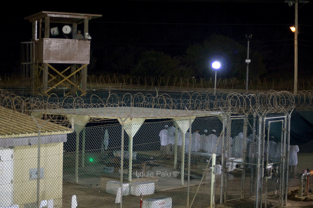 """Detainees praying in Camp 4 at the detention facility in Guantanamo Bay, Cuba. Camp 4 is a communal style camp where more compliant detainees live in small groups and have access to a more open air environment. Approximately 250 """"unlawful enemy combatants"""" captured since the September 11, attacks on the United States continue to be held at the detention facility.(Image reviewed by military official prior to transmission)"""