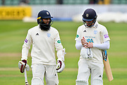 Hashim Amla of Hampshire and Tom Alsop of Hampshire walk off for lunch during the opening day of the Specsavers County Champ Div 1 match between Somerset County Cricket Club and Hampshire County Cricket Club at the Cooper Associates County Ground, Taunton, United Kingdom on 11 May 2018. Picture by Graham Hunt.