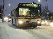 A northbound RTA bus passes a stop on Smithville Road at Wayne Avenue in Dayton's Belmont neighborhood as a wintry mix of snow and sleet falls, early Wednesday morning, February 12, 2008.  northbound Smithville still had a light snow cover, but southbound Smithville was almost clear.