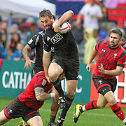 NZ's Kurt Baker breaks a tackle enroute to one of his three tries in the All Blacks 19-7 Quarter Final victory over Wales at the Hong Kong 7's day three, Hong Kong Stadium, Happy Valley, Hong Kong Island, China.   Photo by Barry Markowitz, 4/10/16