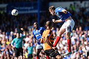 Portsmouth's  Matthew Clarke makes a clearance during the Sky Bet League 2 match between Portsmouth and Barnet at Fratton Park, Portsmouth, England on 12 September 2015. Photo by David Charbit.