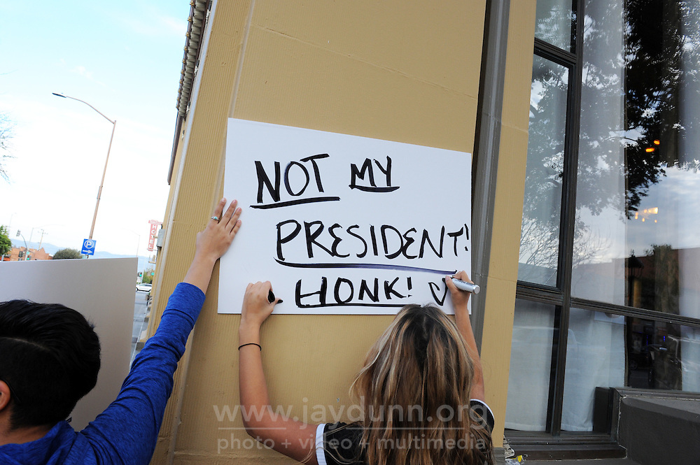 Quickly organized via social media, a protest in Salinas against Donald Trump's election made its way through Main Street in Oldtown on Thursday, with students calling for an end to racist and sexist rhetoric.