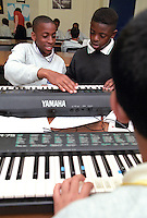 Secondary school students learning to play the Keyboard