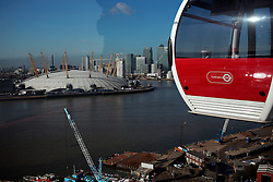 UK ENGLAND LONDON 27FEB15 - Detail view of gondolas of the Emirates Air Line cable car across the river Thames, London. Operated by Transport for London, the service comprises a 1-kilometre (0.62 mi) gondola line that crosses the Thames from the Greenwich Peninsula to the Royal Docks. <br /> <br /> jre/Photo by Jiri Rezac<br /> <br /> © Jiri Rezac 2015