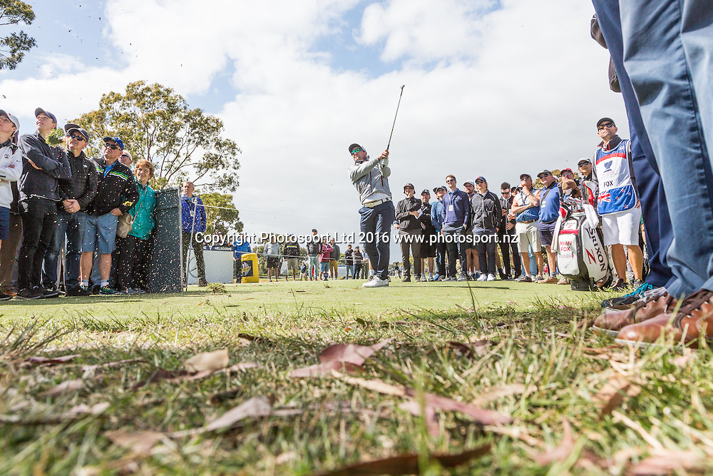 Ryan Fox (NZL)  plays from an opposing tee box following a wayward tee shot as the crowd surround and look on during round 2 of the World Cup of Golf at Kingston Heath Golf Club, Melbourne Australia. Friday 25th November 2016. Copyright Photo Brendon Ratnayake / www.photosport.nz